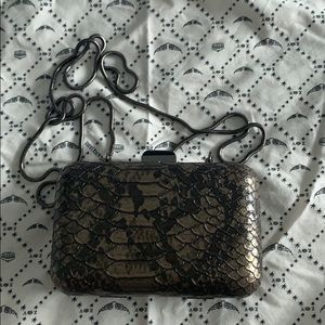 Guess snake embossed clutch